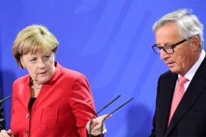Merkel: Poštujem odluku Mej; Junker: Hrabra žena